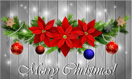 Christmas decoration with evergreen trees with balls gingerbread poinsettia on wood background