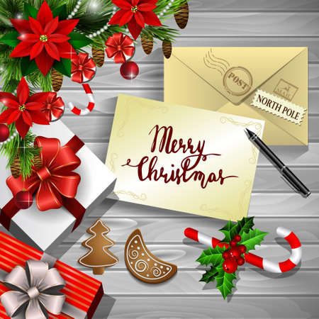 Christmas New Year design wooden background with christmas decorations candy canes with gift boxes and envelope and handwritten Merry Christmas pen and gingerbread cookies and poinsettia in red.