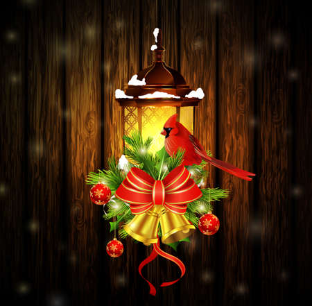 Christmas decoration with street light and evergreen trees and golden bells with red bow and Cardinal bird on wooden background