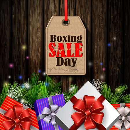 holly day: Boxing day sale tag with evergreen trees with christmas gifts isolated on wooden wall