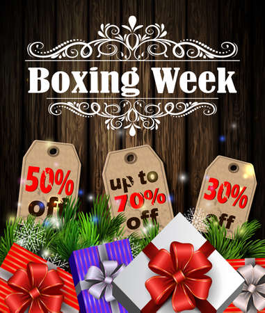 Boxing week sale tags with evergreen trees with christmas gifts isolated on wooden wall Reklamní fotografie - 67516101