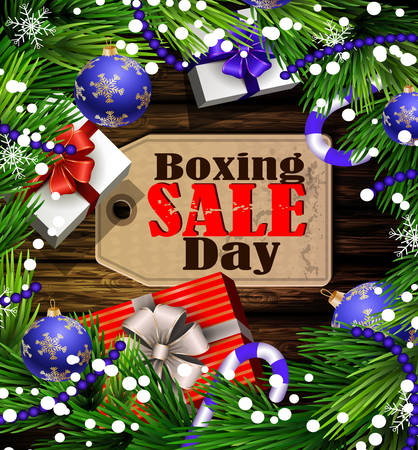 Boxing day sale tag with evergreen trees with christmas gifts and candy canes on wooden wall