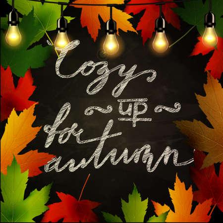 Frame of autumn leaves painted on black chalkboard