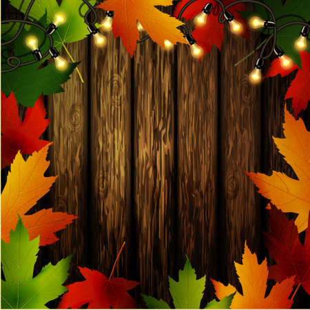 Wooden wall with autumn leaves frame