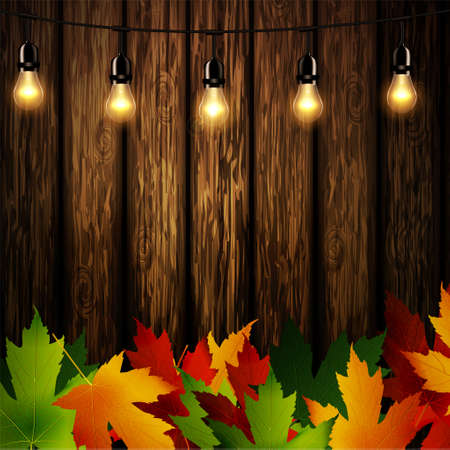 Wooden wall with autumn leaves