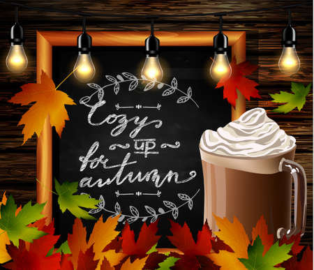 Chalkboard with autumn leaves and cup Hot chocolate and cozy lights