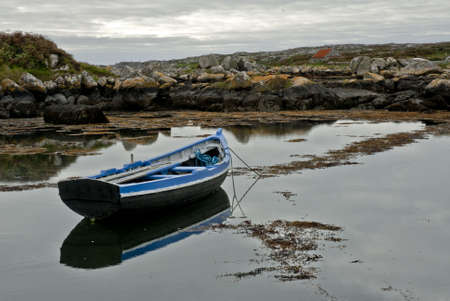connemara: Connemara boat waiting to take the sea. On the background, a ghost town.