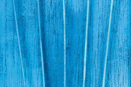 Texture exfoliating cracked blue paint. Vintage wooden background with vertical iron bars, with blue paint. Copy space concept. Stock Photo