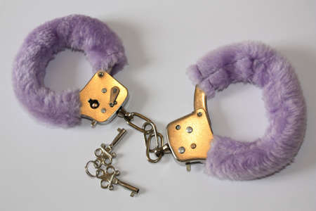 cuffs: purple cuffs Stock Photo