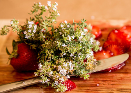 Strawberries with wild flowers photo