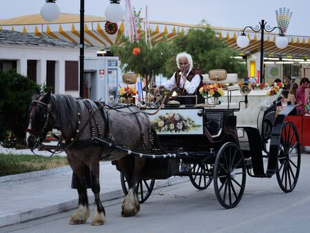 brighter: This grim faced Greek Carriage driver is waiting for tourists and it seems like the brighter future