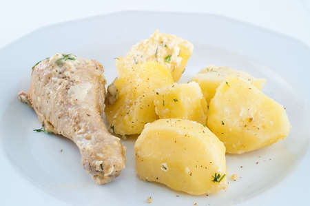 chicken with potato on the plate