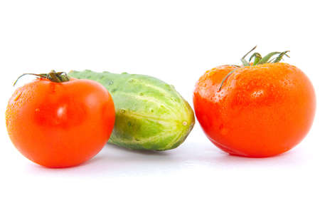 red fresh tomatoes with cucumber isolated on white Standard-Bild