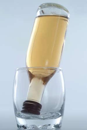 bottle of rum inside glass