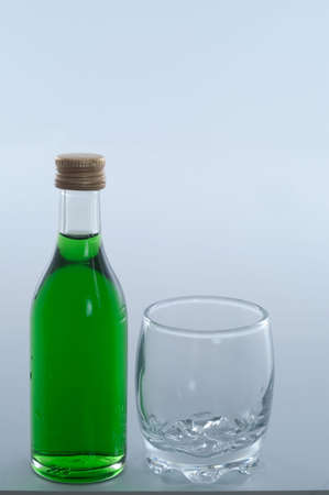 bottle of liqueur with glass