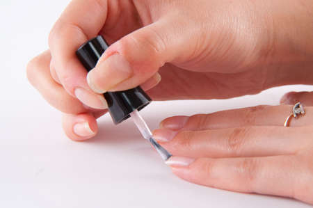 woman painting nails to yourself