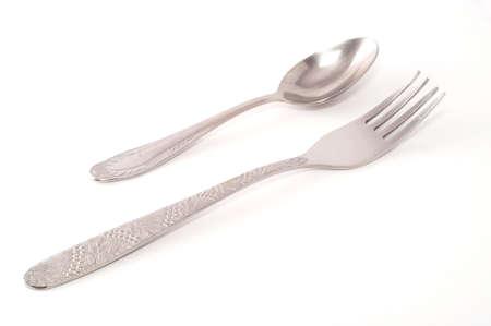 metallic spoon and fork isolated on white Standard-Bild