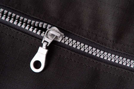 unzip: silver zipper on black cotton