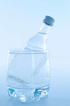 bottle of vodka inside glass