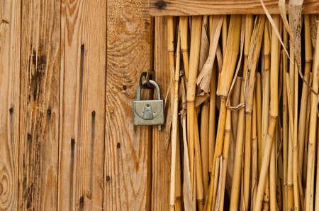 old wooden door with lock Standard-Bild