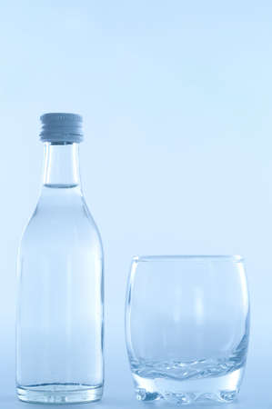 bottle of vodka with glass Standard-Bild