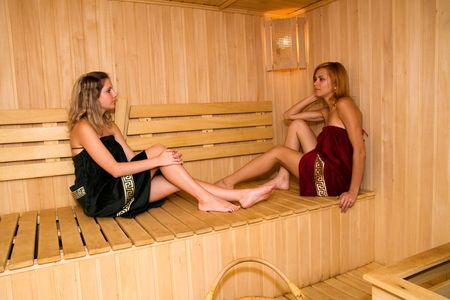 The girls relax in the sauna of his hotel photo