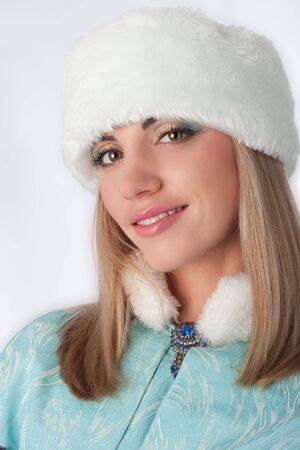 Girl dressed as Russian Santa Claus before Christmas or Happy New Year photo