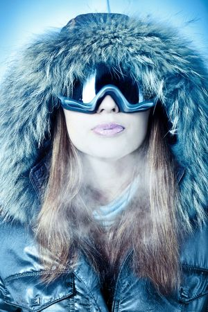 ice queen: Portrait of a woman in a hood and goggles executed in cold tones.