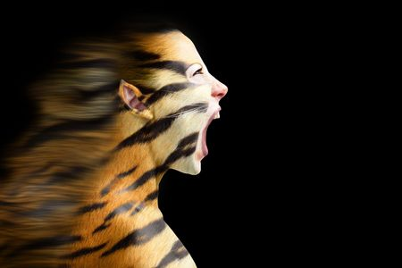 tigress: woman in stylized tiger with  flowing mane Stock Photo