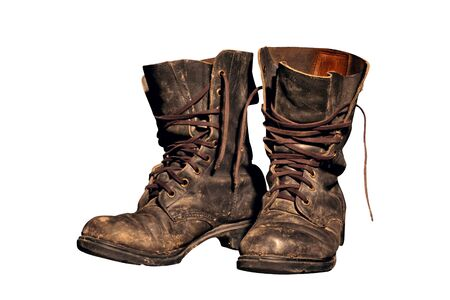 untied: old soldiers boots worn with scratches and untied shoelaces