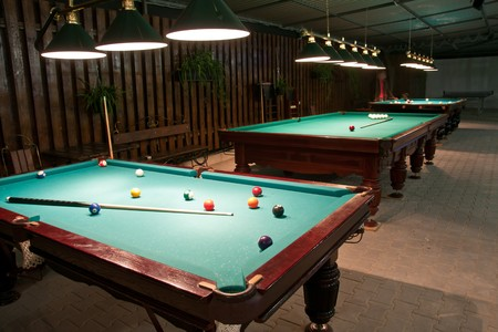 Balls and cue in the American billiards and pool