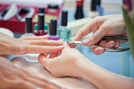 manicure tool does the correction of nails in a beauty salon manicure