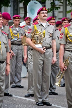 expects: SEVASTOPOL, UKRAINE - 10 June: Ukrainian trumpeter expects ceremonial march, June 10, 2011 in Sevastopol, Ukraine.