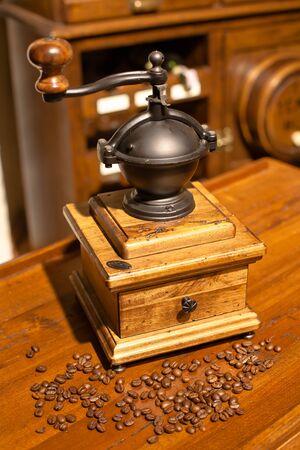 Vintage manual wooden grinder in an antique interior photo