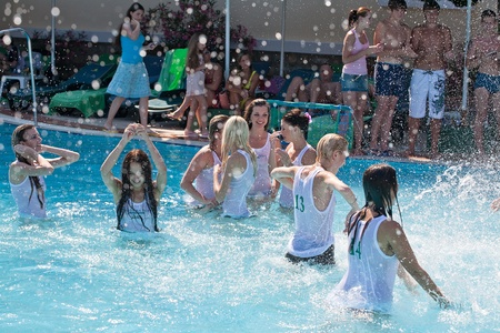 Summer contest wet t-shirts in the pool Stock Photo - 12734806