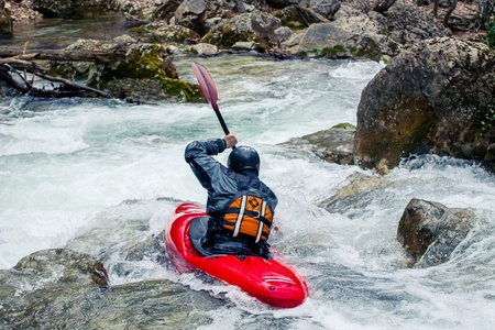 Extreme riding in a canoe on rapid river