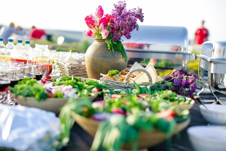 caterer: outside of the eat catering for guests of the event
