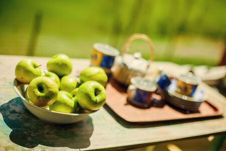 Morning Still Life with green apples and tea service photo