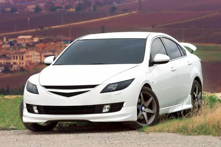 Tuned Mazda Six of white color photo