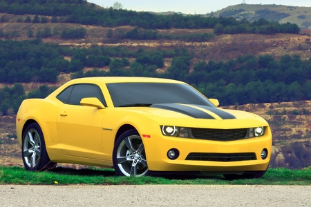 chevrolet: Tuned Chevrolet Camaro yellow with black stripes Stock Photo