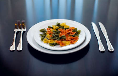 Pasta in the form of ribbons on the plate photo