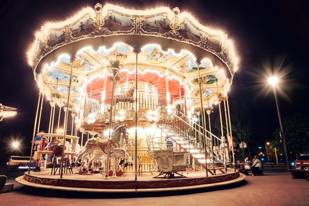 Night view of the illuminated vintage carousel