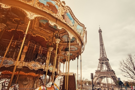 View of the carousel and the Eiffel Tower at sunset