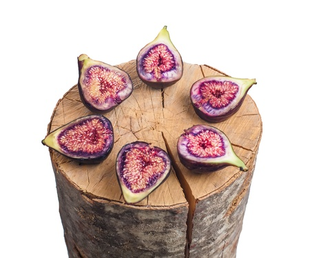 Fruits figs and wooden stump on white background photo