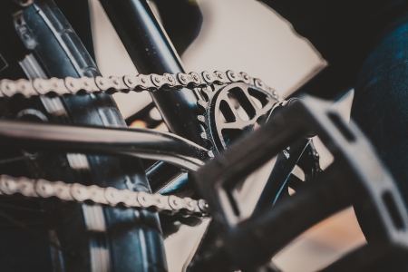 extreme close up: BMX close up the chain and sprocket in trend style. Bicycle background extreme Illustration.