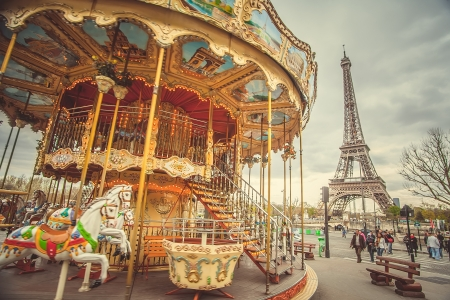 move: The retro carousel and the Eiffel Tower with a retro effect. Trend photography style. Soft and pastel color