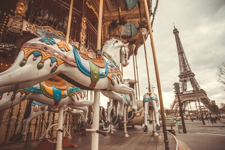 The retro carousel and the Eiffel Tower with a retro effect. Trend photography style. Soft and pastel color