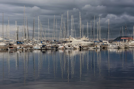 water reflection: Beautiful illustration with yachts in the bay. Luxury boats and reflection in water.