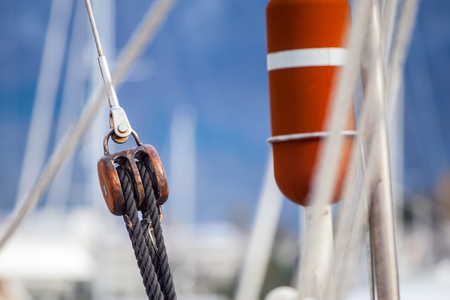 sailboat race: Running rigging gear and sailing rope. Ship tackles on on board yacht. Stock Photo