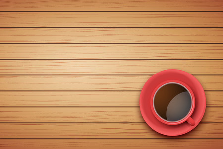 Top view of red cup of coffee or tea on the table light wood with space for text